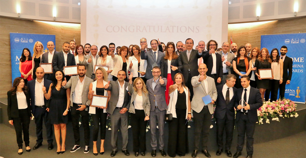 Group photo of the Fattal teams after an awards ceremony at the Bernard Fattal auditorium.