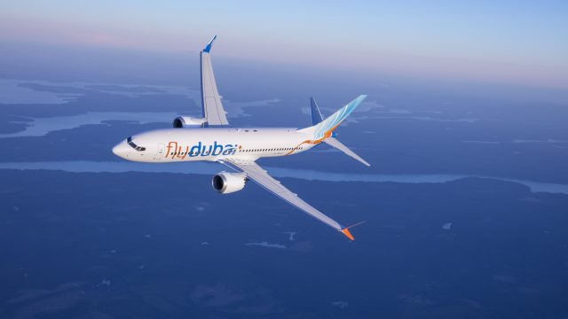 Flydubai Boeing 737 MAX 8 photographed on July 26, 2017 from Wolfe Air Aviation's Learjet 25B.