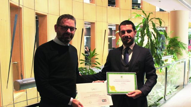 Mr. Mohamad Khaled, Head of Administration - BLOM Bank receiving the certificates from Mr. Rawad Massoud from V4 Advisors