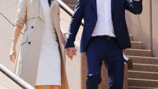 Britain's Prince Harry waves next to wife Meghan, Duchess of Sussex during a visit at the Sydney Opera House in Sydney, Australia October 16, 2018. REUTERS/Phil Noble - RC18EEF32D10
