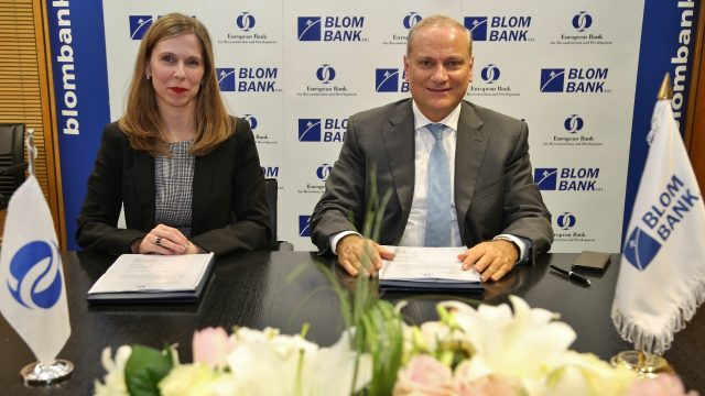 Mr Saad Azhari and Mrs Gretchen Biery signing agreement