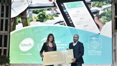 touch Chief Commercial Officer handing over TIP Golden Pass to IOTree Chief Executive Officer Nisrine El Turkey